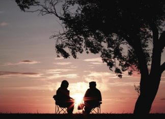 two people sitting in chairs