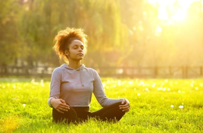 woman sitting in meditation