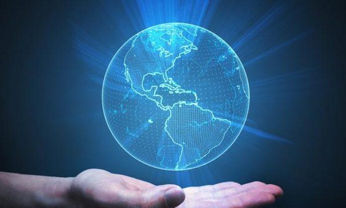 hand holding earth hologram