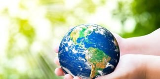 hands holding world