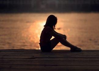 woman sitting by sunset