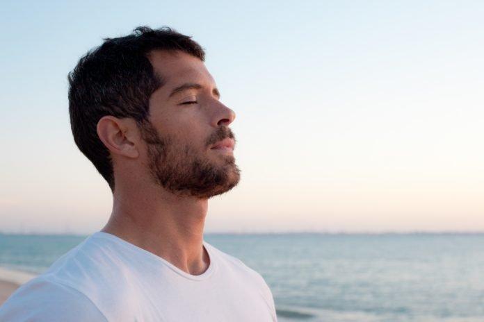 man in white breathing